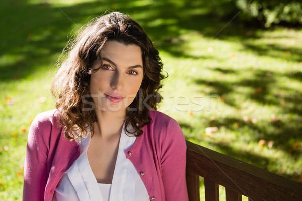 Kadın oturma bank bahçe mutlu Stok fotoğraf © wavebreak_media