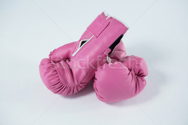 High angle view of pink boxing gloves pair Stock photo © wavebreak_media