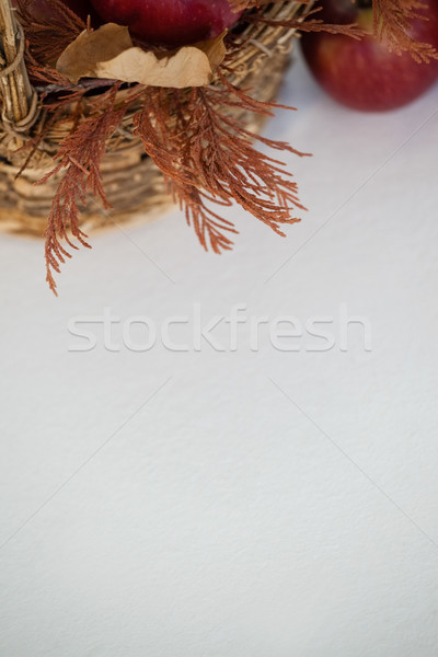 Overhead of red apples with autumn leaves in wicker basket Stock photo © wavebreak_media