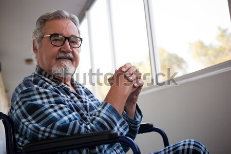Thoughtful senior man sitting on wheelchair in retirement home Stock photo © wavebreak_media