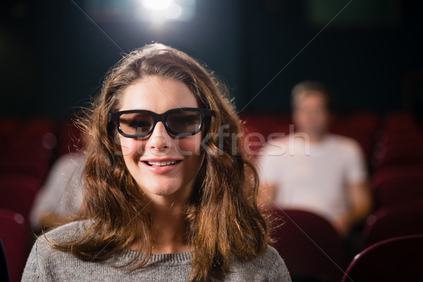 Young woman watching movie in theatre Stock photo © wavebreak_media