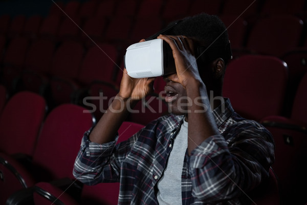 Man using virtual reality headset while watching movie in theatre Stock photo © wavebreak_media