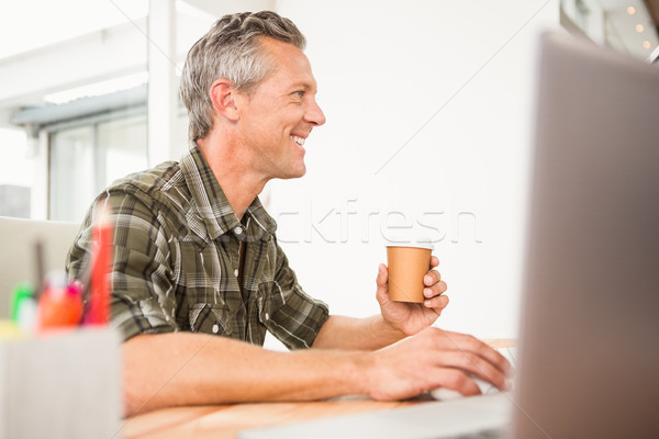 Casual businessman working and having coffee Stock photo © wavebreak_media