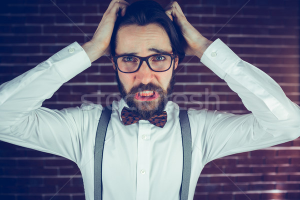 Stock photo: Portrait of worried man with head in hands