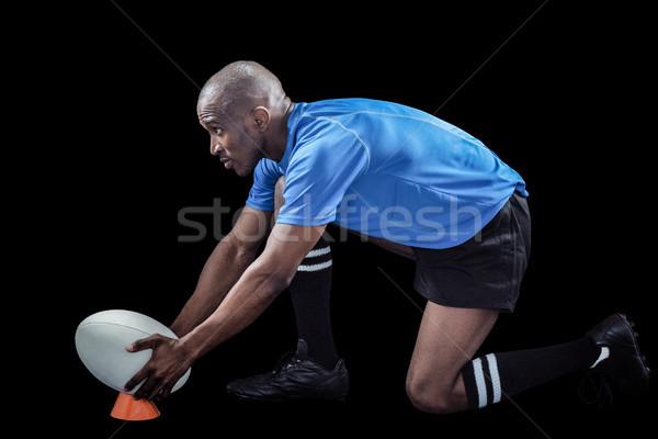 Rugby player keeping ball on kicking tee Stock photo © wavebreak_media