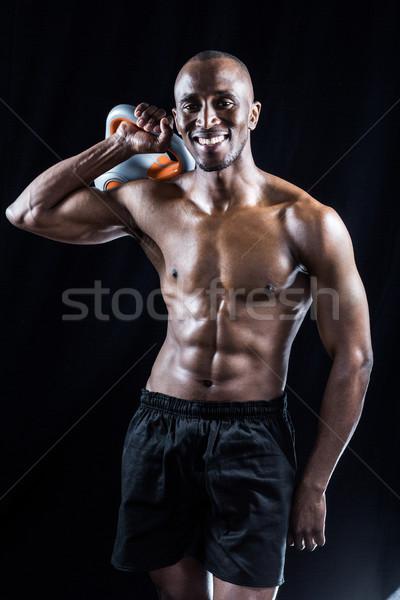 Portret szczęśliwy muskularny człowiek Zdjęcia stock © wavebreak_media