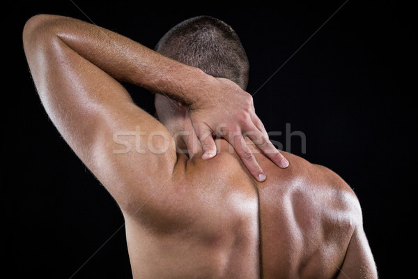 Rear view of shirtless man with neck pain Stock photo © wavebreak_media