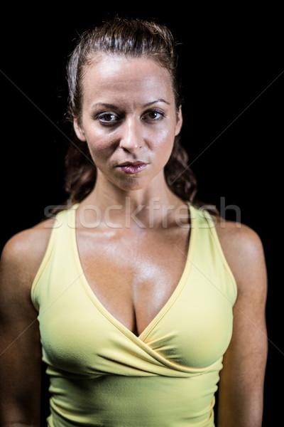 Ritratto bodybuilder giallo abbigliamento sportivo nero donna Foto d'archivio © wavebreak_media