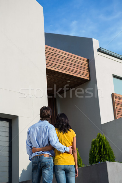 Happy couple standing and looking at the new house Stock photo © wavebreak_media