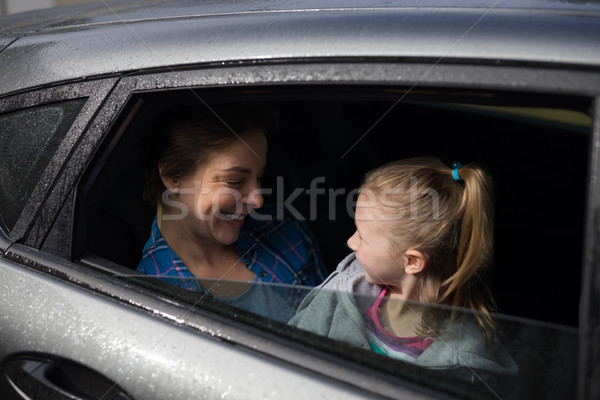 Mother and daughter interacting in the back of the car Stock photo © wavebreak_media