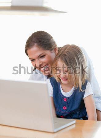 Father and daughter working on laptop Stock photo © wavebreak_media