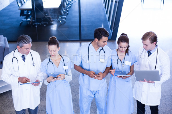 Medical team using laptop, mobile and digital tablet Stock photo © wavebreak_media