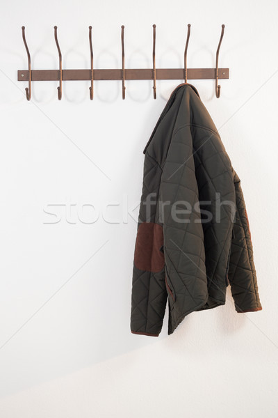 Close-up of warm cloth hanging on hook Stock photo © wavebreak_media