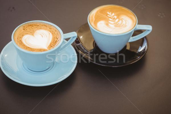 Csésze cappucchino kávé művészet fa asztal kávéház Stock fotó © wavebreak_media