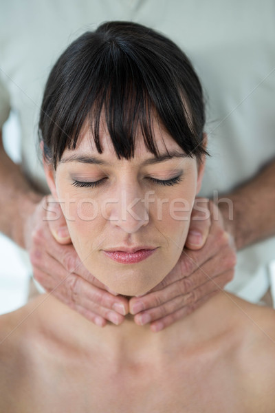 Pregnant woman receiving a massage from masseur Stock photo © wavebreak_media