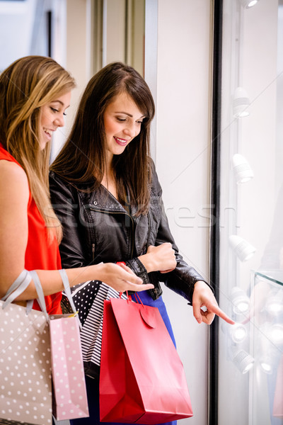 Two beautiful women talking while window shopping Stock photo © wavebreak_media