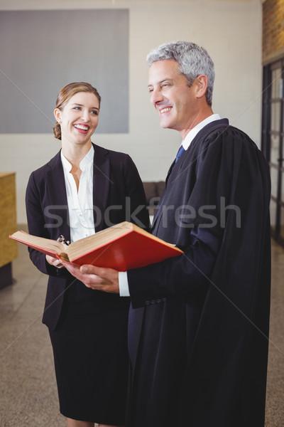 Masculino advogado livro em pé feminino colega Foto stock © wavebreak_media