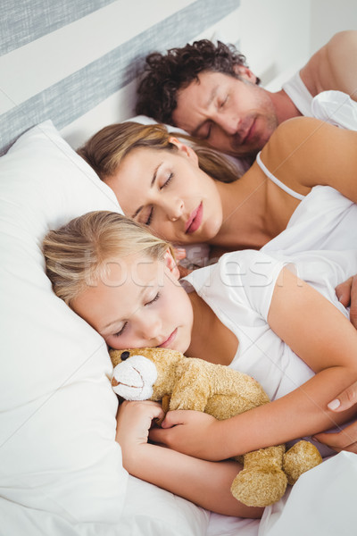 Stock photo: High angle view of parents sleeping with daughter