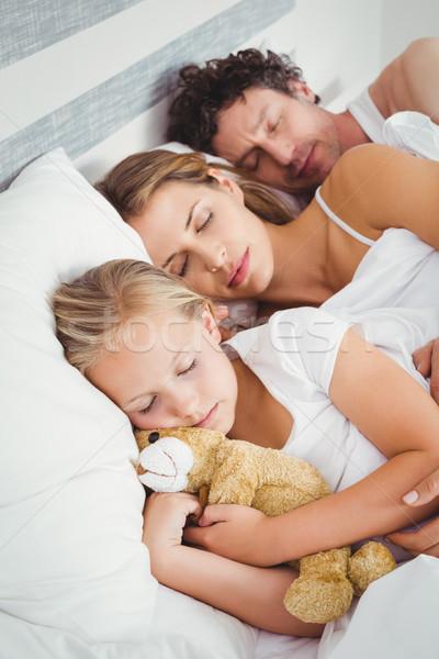 View genitori dormire figlia letto Foto d'archivio © wavebreak_media