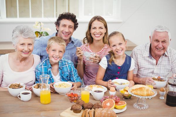 Multi-generation family having breakfast at home Stock photo © wavebreak_media