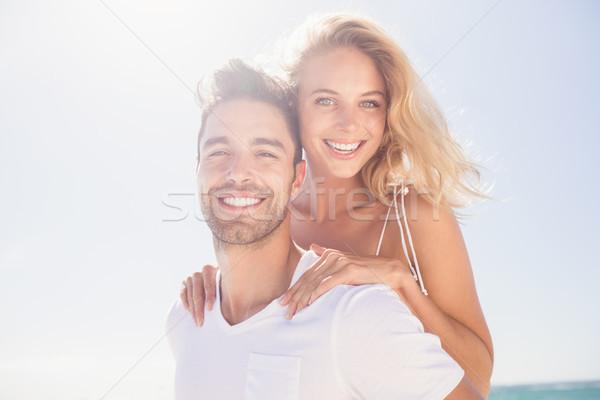 Boyfriend giving piggy back to girlfriend Stock photo © wavebreak_media
