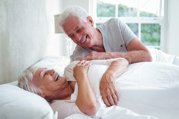 Smiling senior couple relaxing on bed  Stock photo © wavebreak_media