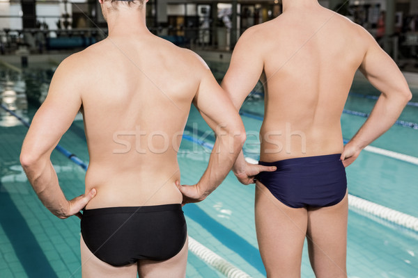 Rear view of swimmers standing by the pool Stock photo © wavebreak_media