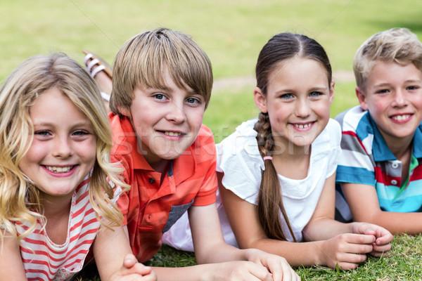счастливым детей трава портрет парка девушки Сток-фото © wavebreak_media