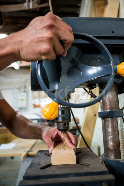 Carpenter using a drill Stock photo © wavebreak_media