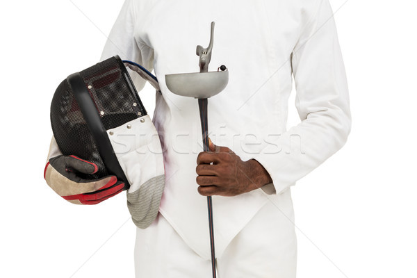 Mid-section of man standing with fencing mask and sword Stock photo © wavebreak_media