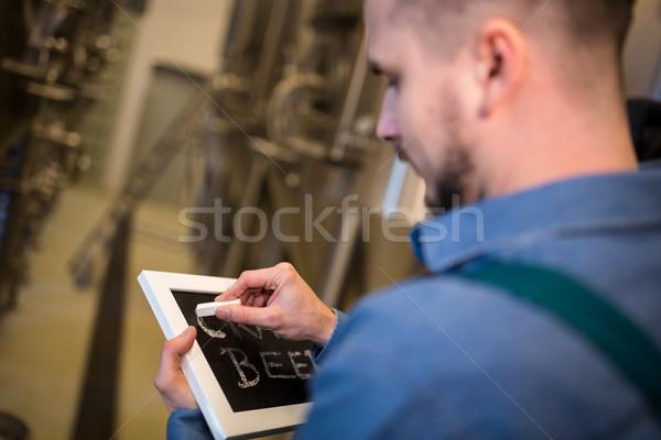 Brewer writing on slate Stock photo © wavebreak_media