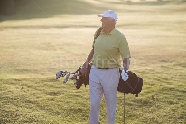Happy man carrying golf bag Stock photo © wavebreak_media