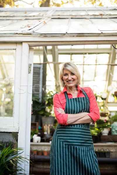 Confident woman standing at doorway in greenhouse Stock photo © wavebreak_media