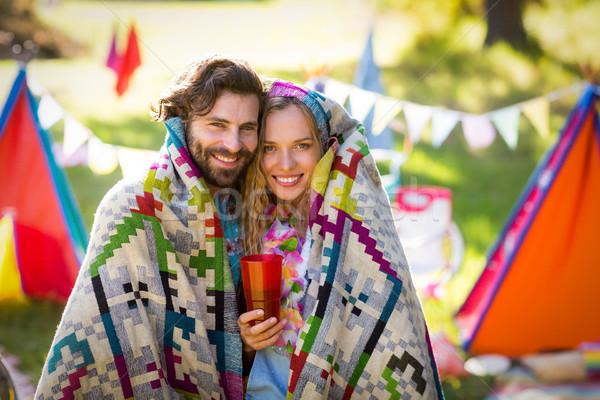 Couple wrap themselves in blanket Stock photo © wavebreak_media