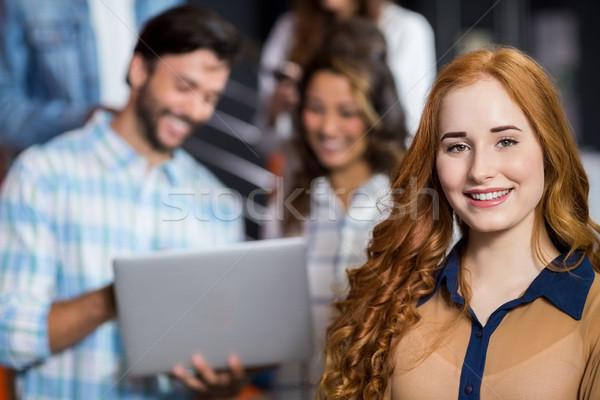 Portrait souriant Homme exécutif bureau portable Photo stock © wavebreak_media