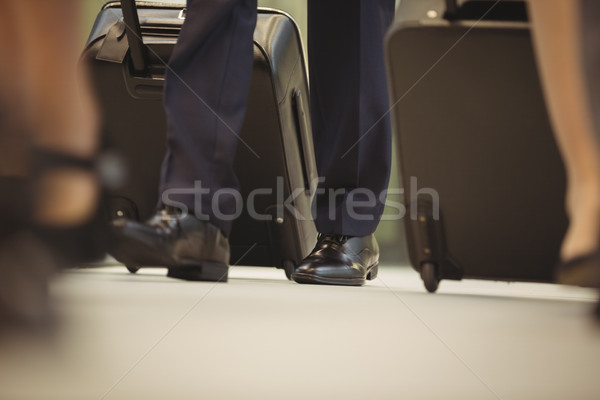 Stock photo: Businessman with trolley bag walking