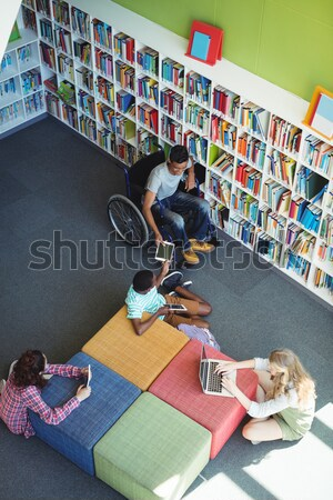 Overhead view of attentive students studying in library at school Stock photo © wavebreak_media