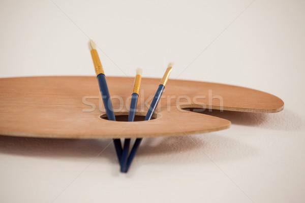 Wooden palette and paint brushes Stock photo © wavebreak_media