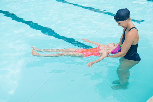 Female instructor training young girl in pool Stock photo © wavebreak_media