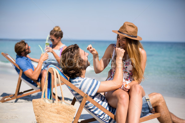 Romantica coppie seduta deck sedie spiaggia Foto d'archivio © wavebreak_media