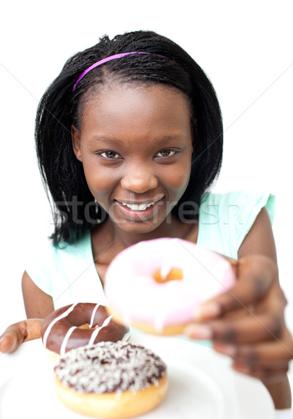Stock photo: Pretty young woman holding a donut
