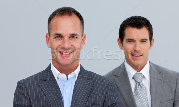Portrait of smiling businessmen with folded arms Stock photo © wavebreak_media