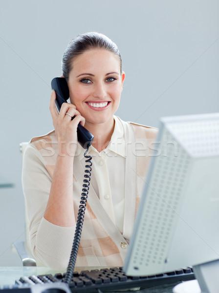 Lelkes üzletasszony beszél telefon iroda telefon Stock fotó © wavebreak_media