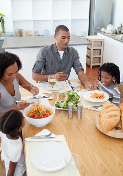Loving family dining together Stock photo © wavebreak_media
