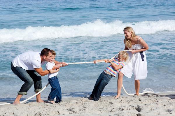 семьи играет войны пляж девушки Сток-фото © wavebreak_media