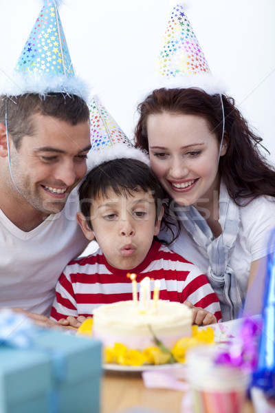 Little boy blowing out candles on his birthday's day Stock photo © wavebreak_media
