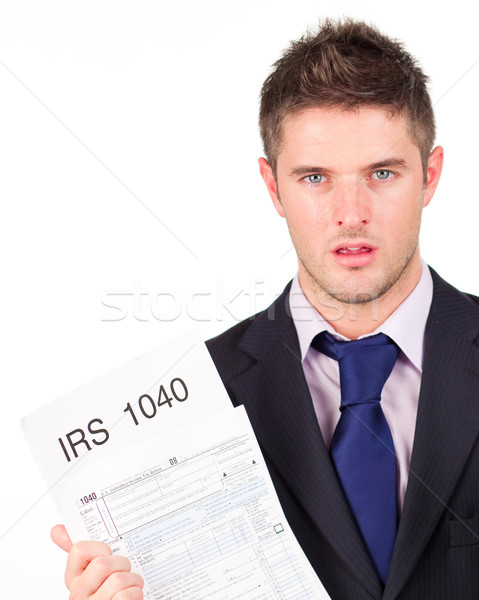 Man holding out his irs returns form Stock photo © wavebreak_media