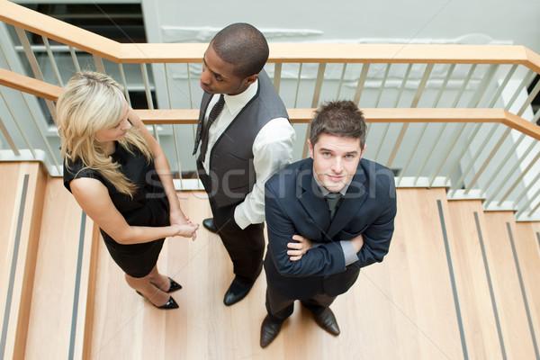 Empresário empresária aperto de mãos homem dobrado brasão Foto stock © wavebreak_media
