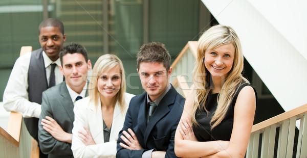 Gens d'affaires regarder caméra pliées bras escaliers Photo stock © wavebreak_media