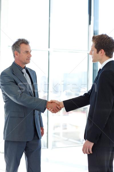 Senior and junior businessman shaking hands in agreement Stock photo © wavebreak_media